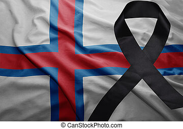 flag of faroe islands with black mourning ribbon
