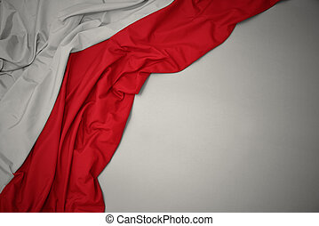 waving national flag of poland on a gray background.