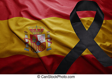 flag of spain with black mourning ribbon - waving national...