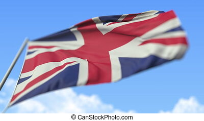 Waving national flag of the United Kingdom, low angle view. Loopable slow motion 3D animation