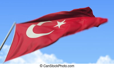 Waving national flag of Turkey, low angle view. Loopable realistic slow motion 3D animation