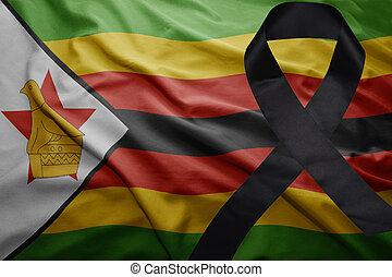 flag of zimbabwe with black mourning ribbon