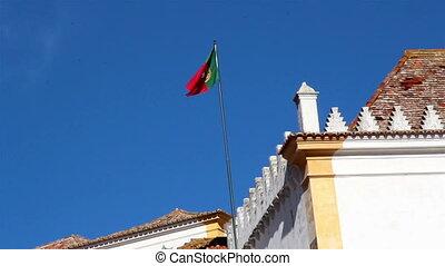 Waving Portugal flag on a blue sky