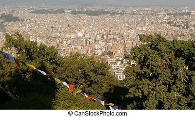 Waving prayer flags against cityscape. View of waving ...
