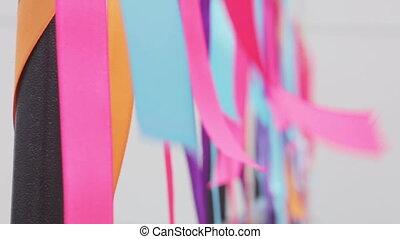 Waving ribbons - Holiday decoration on multicolored ribbons