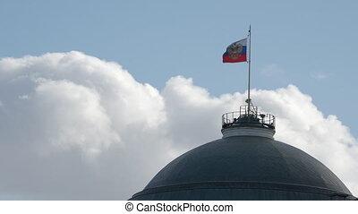Waving Russian flag on top of dome of Kremlin Senate....