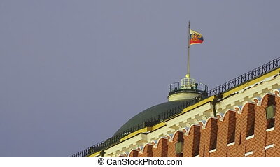 Waving Russian flag on top of dome of Kremlin Senate....