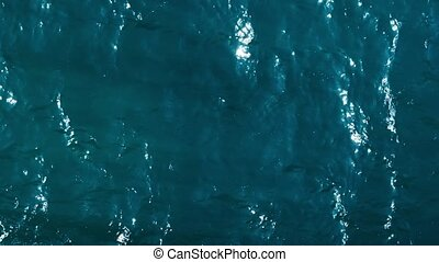 Waving turquoise water - Top view on waving turquoise water