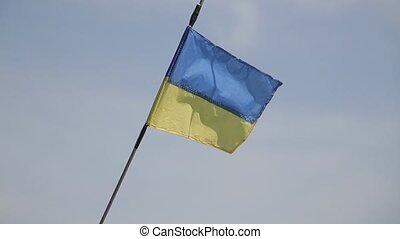 Waving ukrainian flag on sky background