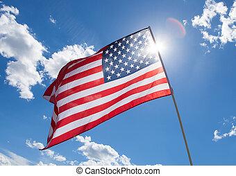 USA flag on blue sky background