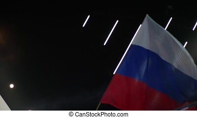 Waving with big russian flag. Slow motion