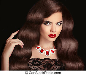 Beautiful Brunette Woman. Red Lips makeup. Healthy Long Brown Hairstyle. Fashion necklace jewelry.  Beauty girl  Model isolated on black background.