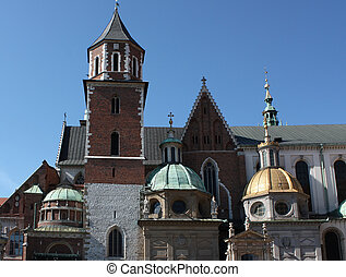 View of the southern side of the Wawel Cathedral including the Vasa and golden Sigismund chapel in Krakow, Poland. Shot on a clear sunny day.