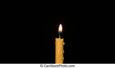 Wax candle flares on a black background