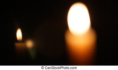 Wax candle light in darkness