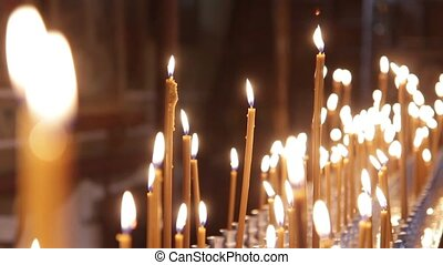 Wax candles burning in the Orthodox Church. There Is The...