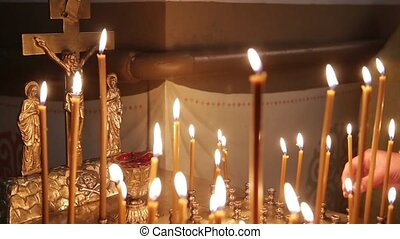 Wax Candles Burning In The Orthodox Church. There Is The Sound