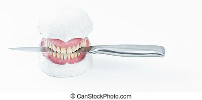 wax denture wth a knife