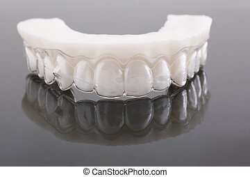 Wax pattern teeth dental crowns on model, metal free - front view .Ceramic front veneers isolated on black background. Metal-Ceramic crowns on gypsum model in dental laboratory.