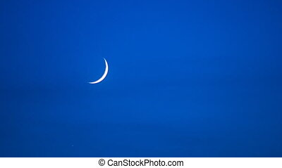 waxing crescent moon on the sky timelapse - waxing crescent...