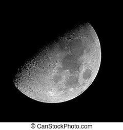 Quarter moon on the black night sky.