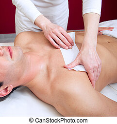 Waxing - Male depilation with wax in salon