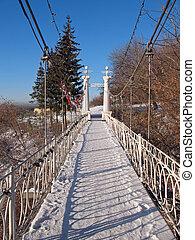 Way - Little bridge under slope in the park.