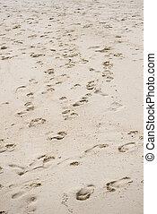 Way of human footprints on the beach sand