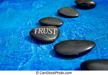 """way of trust - Line of stones with engraved word \""""trust\""""..."""