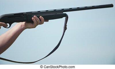 Way-out shotgun shooting and cartridge case rushing out...