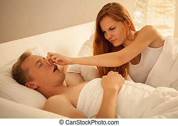 Way to stop snoring - Young angry woman and her way to stop...