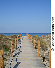 Way to the beach - A path of wooden planks leading to the...