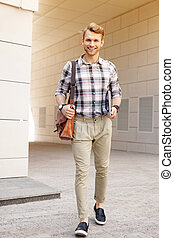Positive young man walking