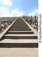 Way up the ladder to ridge of dam
