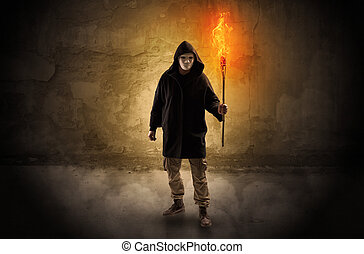 Wayfarer with burning torch in front of crumbly wall concept...