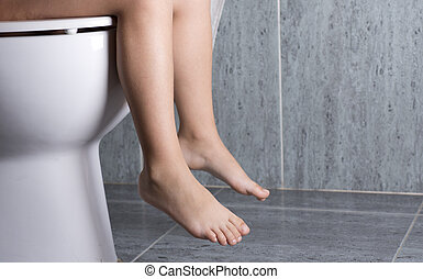 wc girl - a little girl sitting on a toilet peeing