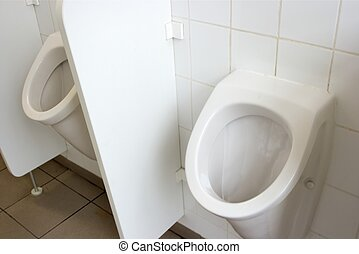 WC - Mens toilet inside, two urinals, white wall