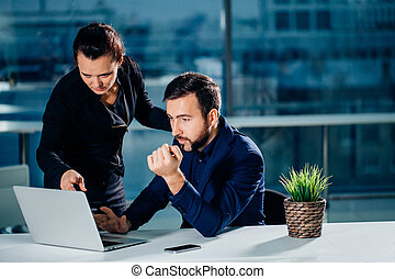 We already have great results. woman pointing at laptop with...