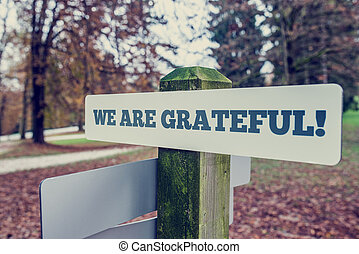 We Are Grateful concept with an angled signboard with the ...