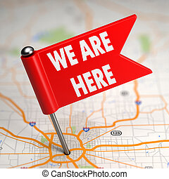 We Are Here - Small Flag on a Map Background. - We Are Here...