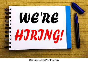 We Are Hiring Now. Business concept for Recruitment Human Resources Written on notepad note paper background with space office view with pencil marker
