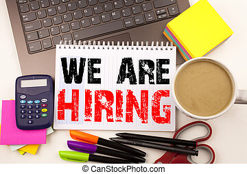 We Are Hiring Writing text in the office with surroundings such as laptop, marker, pen, stationery. Business concept for Recruitment and Job recruiting advertisement white background with copy space