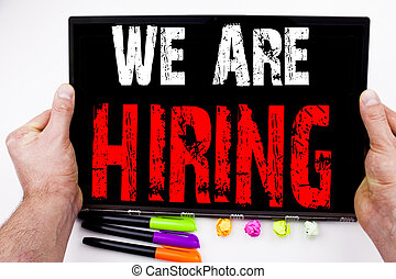 We Are Hiring Writing text written on tablet, computer in the office with marker, pen, stationery. Business concept for Recruitment and Job recruiting advertisement white background with copy space