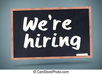 We are hiring written on chalkboard against grey background