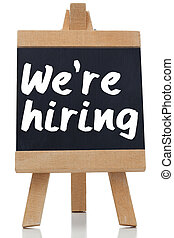 We are hiring written with a chalk on blackboard against ...