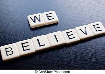 We believe on dark wood background - Alphabet Blocks...