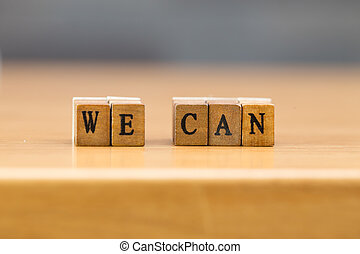 We can. word written on wood block