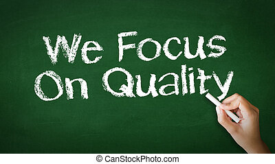 We Focus On Quality - A person drawing and pointing at a We...