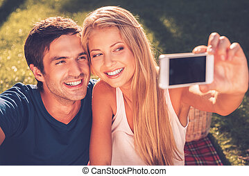 Catching A Bright Moment Happy Young Loving Couple Making Selfie