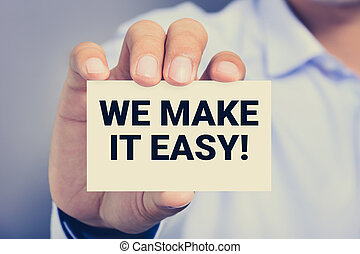 WE MAKE IT EASY! message on the card shown by a man